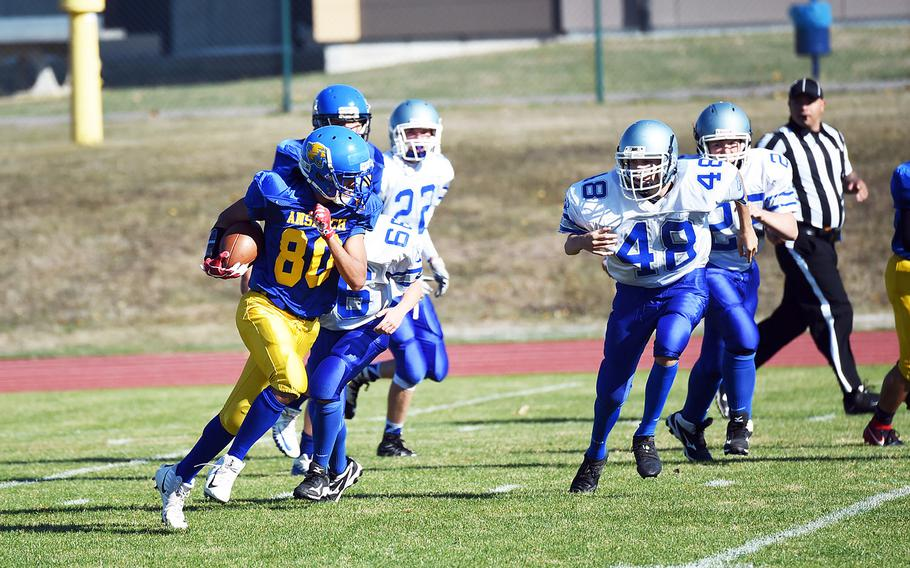 Ansbach's Tyrese King runs with the ball he just stripped from a Brussels Brigand on his way to the first touchdown of his career during a game at Ansbach, Germany, Saturday, Oct. 13, 2018.