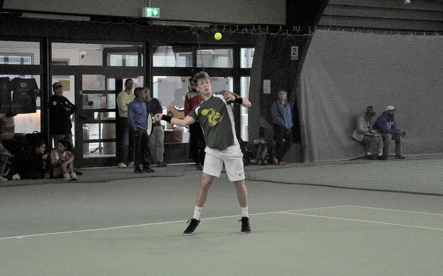 SHAPE's Noah Banken returns a shot against Wiesbaden's Benjamin Petrik on Thursday at Vitis Tennis Center in Wiesbaden, Germany. Banken won the boys singles preliminary match in the 2018 DODEA-Europe tennis tournament 6-0, 6-0.