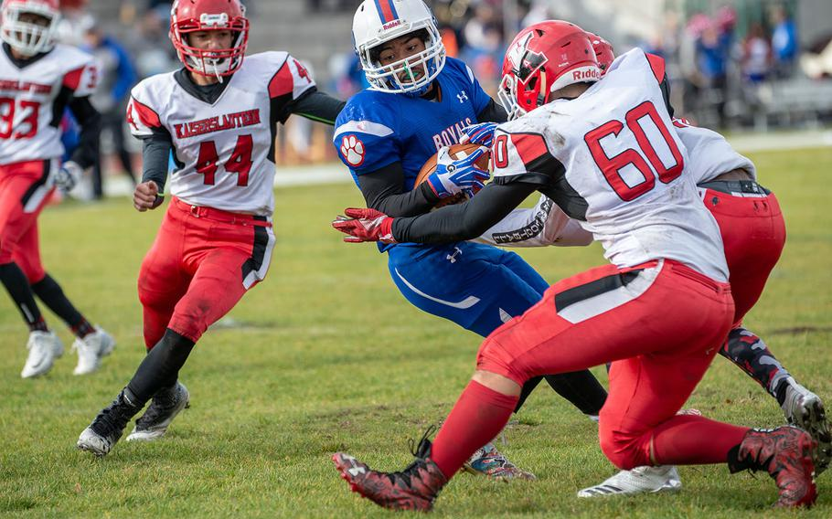 Dominque Arizpe breaks a tackle before scoring during the Ramstein vs Kaiserslautern football game at Ramstein, Germany, Saturday, Oct. 27, 2018.