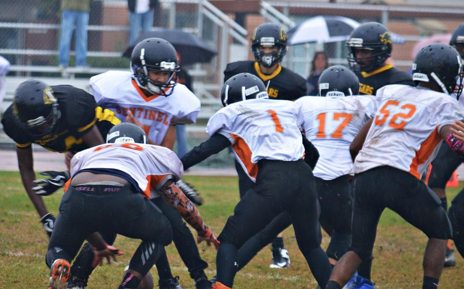 Players from Vicenza and Spangdhalem attempt to recover a fumble during Saturday's game. The Cougars defeated the Sentinels 39-3.