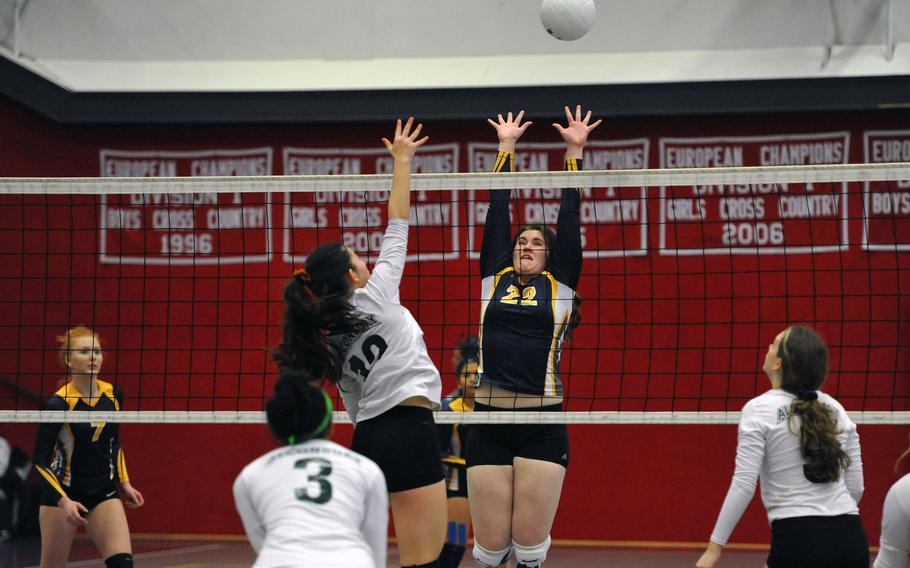 Ansbach's Maddie Liverar tries to block Alconbury's Anna Downing in a Division III match at the DODEA-Europe volleyball finals in Kaiserslautern, Germany, Thursday, Nov. 1, 2018. Alconbury won the match 25-18 25-18 25-21.