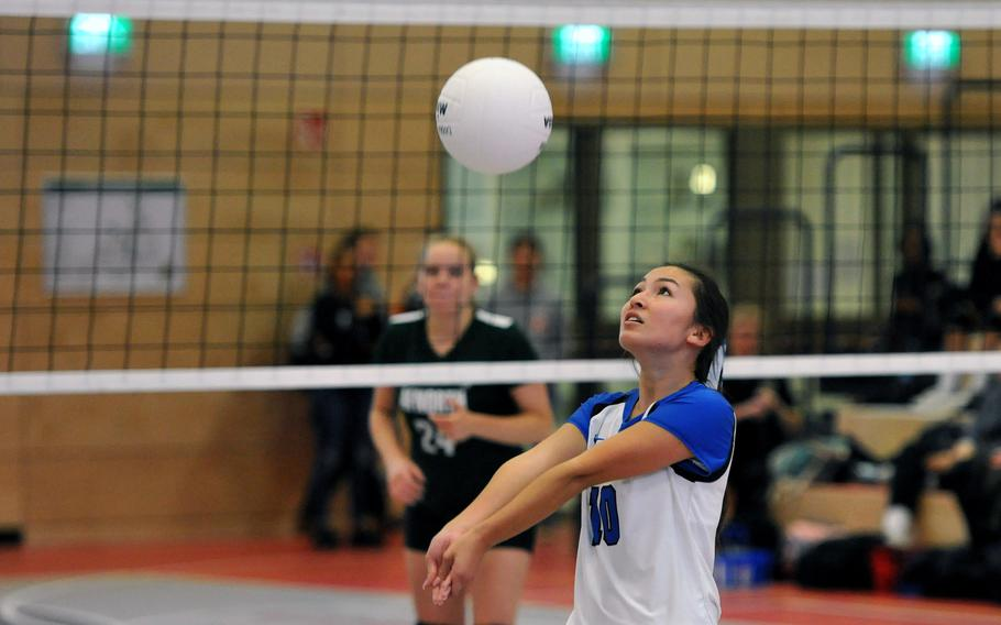 Rota's Avery Nance keeps her eyes on the ball as AFNORTH's Josie Bosch watches from across the net in a Division II match at the DODEA-Europe volleyball finals in Kaiserslautern, Germany, Thursday, Nov. 1, 2018. AFNORTH won 25-11, 25-13, 25-12.