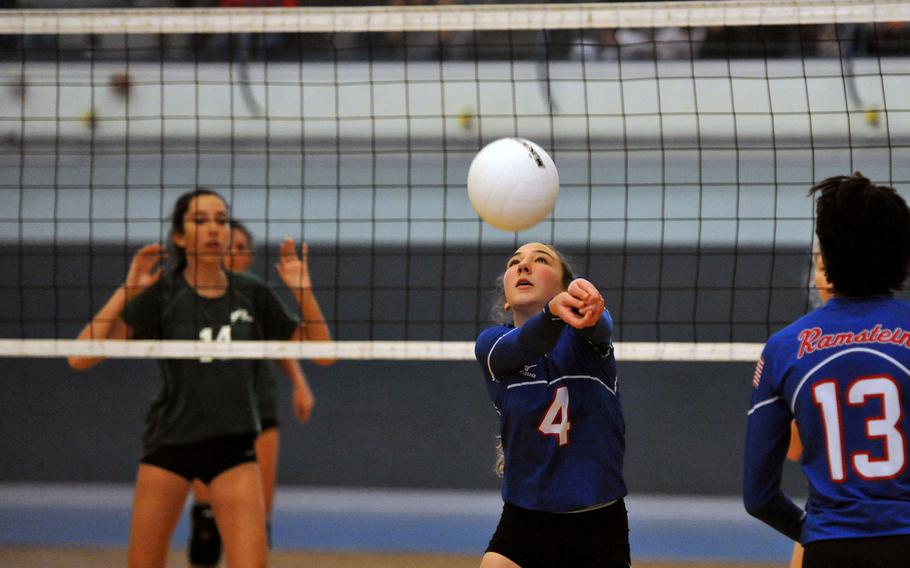 Ramstein's Sydney Gabriel returns a ball as teammate Jaya Worthington, right, and Lena Diercykx of Naples follow the action. Ramstein beat Naples 25-11, 25-23, 25-14 on opening day of the DODEA-Europe volleyball finals in Kaiserslautern, Germany, Thursday, Nov. 1, 2018.