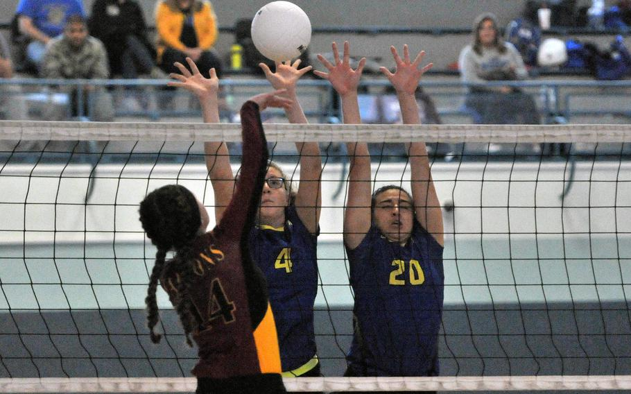 Vilseck's Isabela Fedorisin attempt to get a shot past the Wiesbaden block of Hannah Dillard, left, and Allaina Houk in Division I action at the DODEA-Europe volleyball finals in Kaiserslautern, Germany, Thursday, Nov. 1, 2018. Wiesbaden won 25-12, 25-22, 25-13.