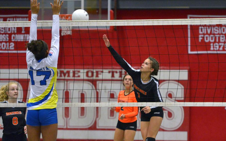 Spandahlem's Koder Teahon hits agains Sigonella's D'Anna Holland in in a Division III semifinal at the DODEA-Europe volleyball finals in Kaiserslautern, Germany, Friday, Nov. 2, 2018. Sigonella advanced to Saturday's final against Brussels with a 25-17, 25-20, 21-25, 25-20 win.