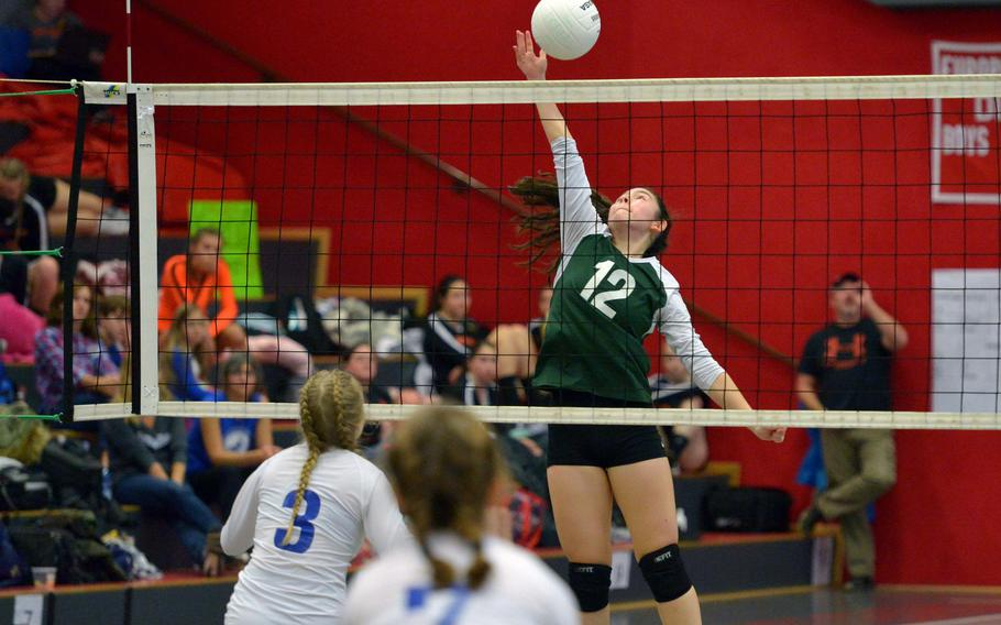 Alconbury's Anna Downing goes high at the net in the Dragons' 17-25, 25-20, 25-22,26-24 loss to Brussels in a Division III semifinal at the DODEA-Europe volleyball finals in Kaiserslautern, Germany, Friday, Nov. 2, 2018.