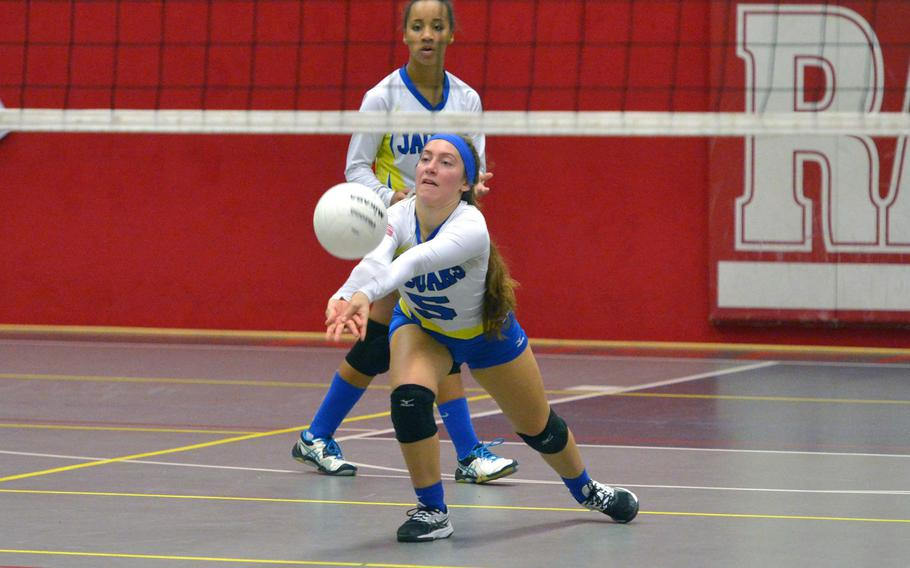 Sigonella's Jessie Jacobs digs out a Spangdahlem serve as teammate Averi Chandler watches. Sigonella defeated Spangdahlem 25-17, 25-20, 21-25, 25-20  in a Division III semifinal at the DODEA-Europe volleyball finals in Kaiserslautern, Germany, Friday, Nov. 2, 2018.