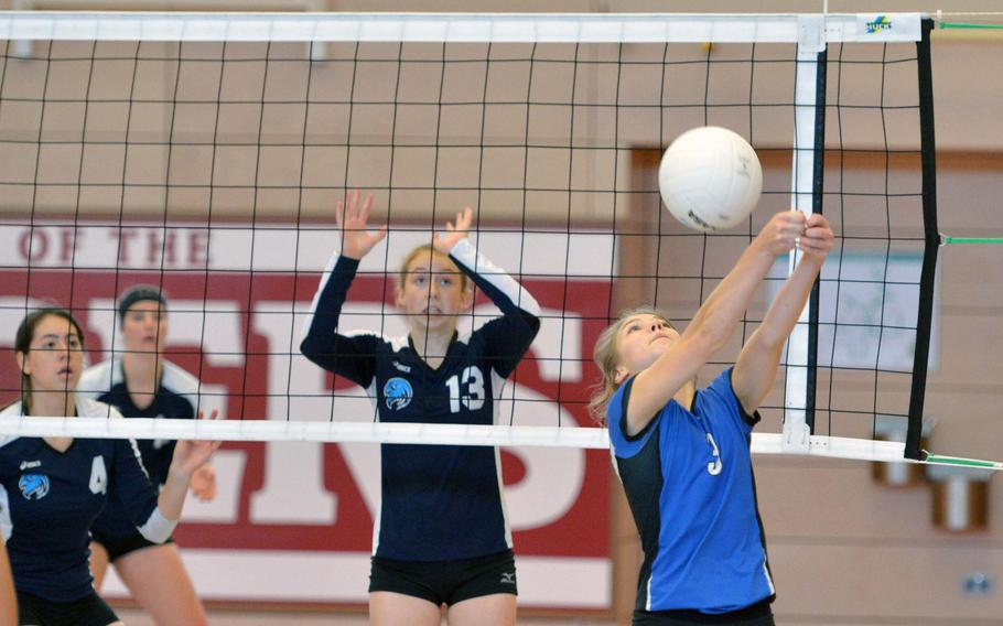 Rota's Nysa Stepp returns a shot as Black Forest Academy's Kennedy Willbanks, left, and Melody Miller defend. BFA beat Rota 25-11, 25-22, 25-16 and will face Marymount in Saturday's final.