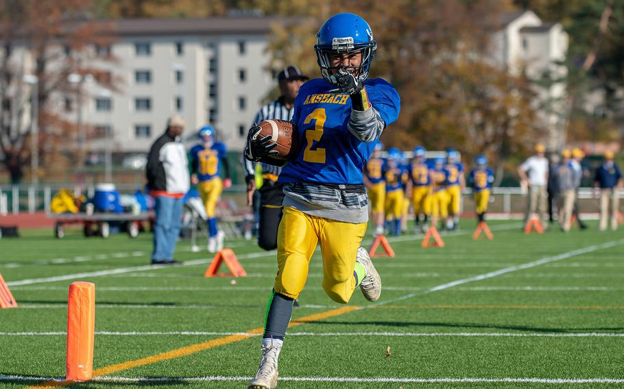 Rovic Denuna from Ansbach crossed the goal line during the DODEA-Europe Division III football championship game between the Ansbach Cougars and AFNORTH Lions, Saturday, Nov. 3, 2018.