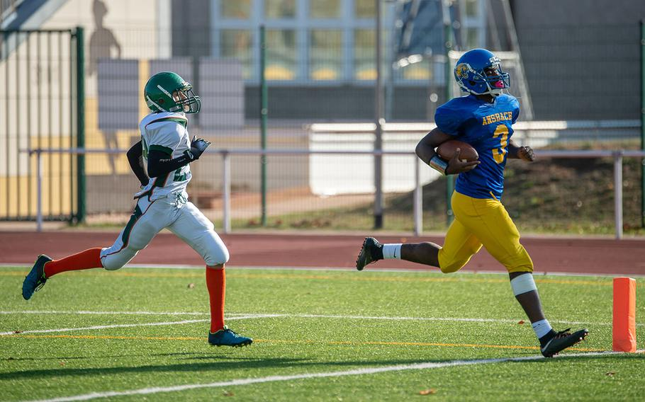 Ogden Andrew from Ansbach in scores during the DODEA-Europe Division III football championship game between the Ansbach Cougars and AFNORTH Lions, Saturday, Nov. 3, 2018.