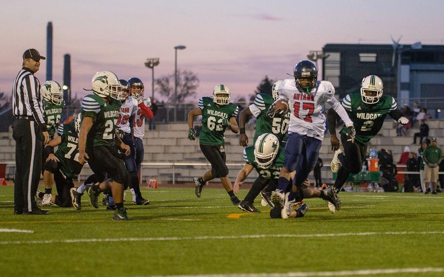 Josiah Cooper from Aviano breaks the last tackle to score during the DODEA-Europe Dvision II football championship game between the Aviano Saints and the Naples Wildcats, Saturday, Nov. 3, 2018.