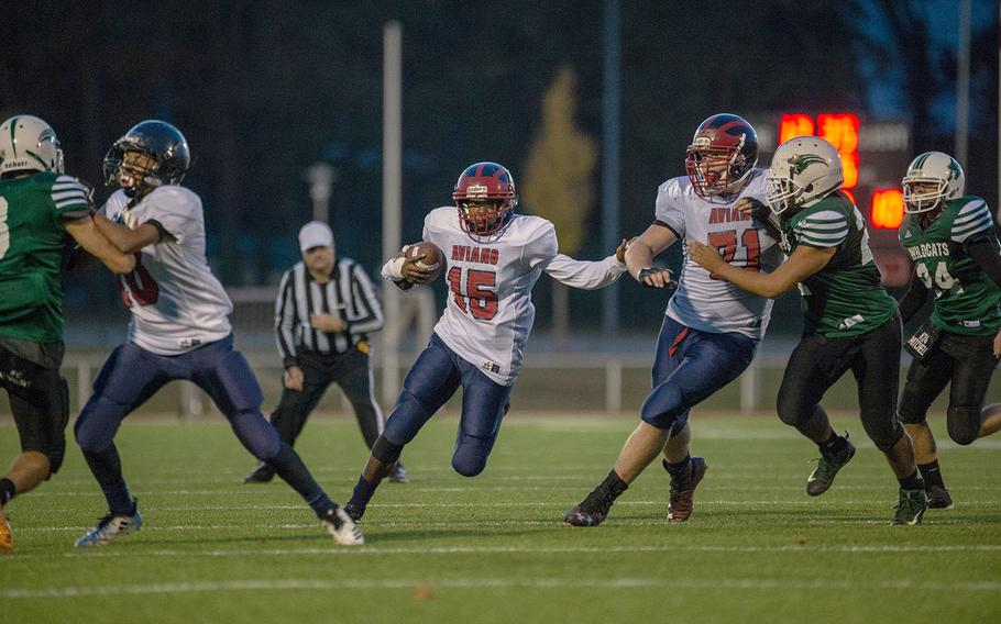 Donavin Robinson from Aviano finds a running lane during the DODEA-Europe Division II football championship game between the Aviano Saints and the Naples Wildcats, Saturday, Nov. 3, 2018.