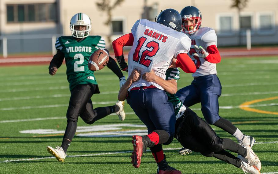 Nick Smith from Aviano is hit and fumbles during the DODEA-Europe Division II football championship game between the Aviano Saints and the Naples Wildcats, Saturday, Nov. 3, 2018.