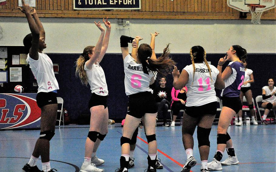 Members of Team Hope celebrate a point in a 2018 DODEA-Europe volleyball all-star match Saturday, Nov. 10, 2018 at Ramstein Air Base, Germany.