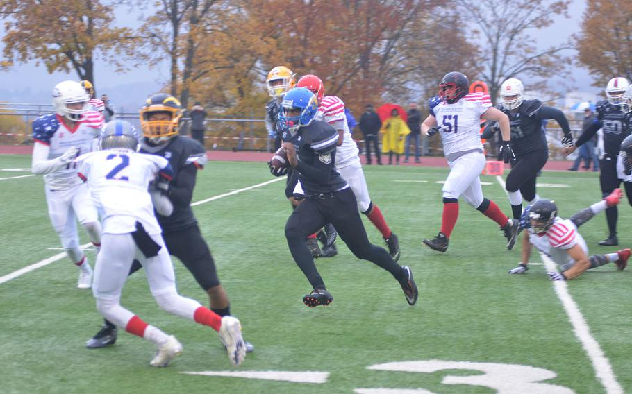 Ansbach's Ogden Andrew attempts to score a touchdown during the 2018 European All-Star High School football game in Wiesbaden, Germany on Saturday.