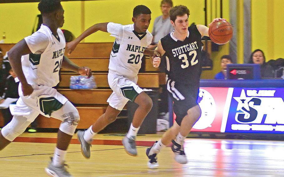 Stuttgart's Logan Crouch tries to beat Naples' Biniam Stefanos and Ashton Jeanty, left, down the court in the Wildcats' 46-44 victory in December.  DODEA-Europe sports gets underway again this weekend after the Christmas break.