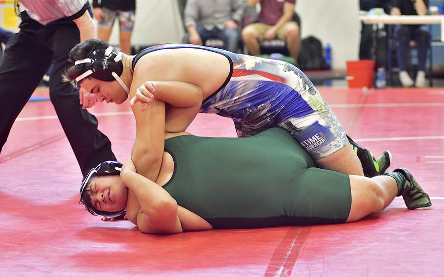 Augusto De Sousa Matos from Naples attempts to pin Xzavyer Salas, also from Naples, during Saturday's wrestling tournament held at Aviano Air Base. De Sousa Matos and Salas compete in the 220-pound bracket. De Sousa won all his matches during the tournament.
