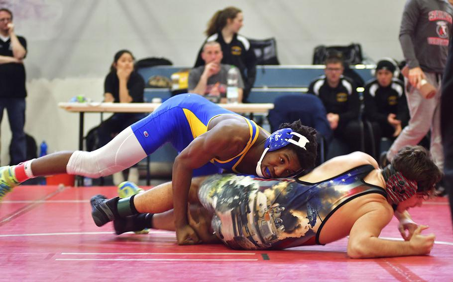 Amari Pyatt, a junior from Sigonella, wrestles Matthew Hanford-Garcia from Naples during Saturday's wrestling tournament held at Aviano Air Base. Pyatt is a recent transfer to Sigonella and is originally from Belleview, Neb. Before transferring to Italy, Pyatt was ranked sixth amongst all Nebraska's high school wrestlers.  He wrestled in the 170-pound bracket at this tournament.