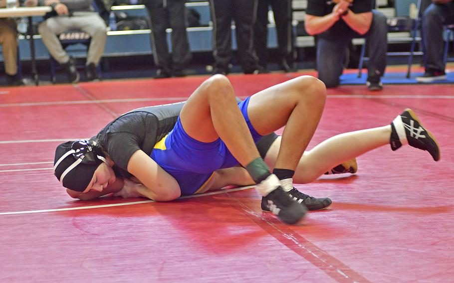 Olivia Crutchley from Vicenza works on pinning Arland Matthias from Sigonella during Saturday's wrestling tournament held at Aviano Air Base. Crutchley is one of three girls on the Vicenza wrestling team. She wrestled in the 145-pound bracket at this tournament.