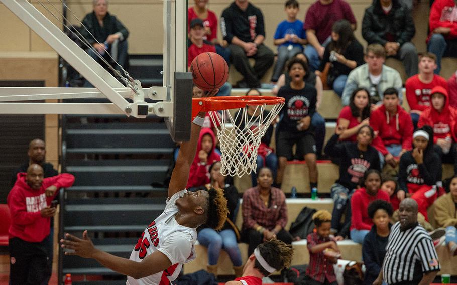 Tre Dotson goes up for a lay-up during the Kaiserslautern vs Lakenheath boys basketball game at Kaiserslautern High School, Friday, Jan. 18, 2019.  Kaiserslautern won the game 62-59.