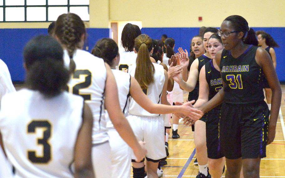 The Falcons and Cougars shake hands after a game between Division II Bahrain and Division I Vicenza  on Friday, Jan. 18, 2019. The Falcons won the game 33-31.