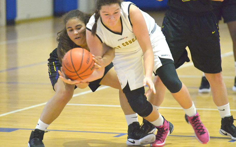 Cougar Brealin Redecker and Falcon Mina Testh fight for a loose ball during a game between Division II Bahrain and Division I Vicenza on Friday, Jan. 18, 2019. The Falcons pulled off an upset victory against the Cougars, winning the game 33-31.