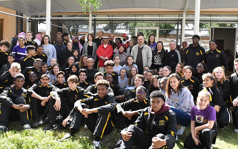 The Bahrain and Vicenza high school basketball teams take a photo with King Hamad bin Isa Al Khalifa of Bahrain at the Royal Endurance Village where the king was in attendance for a horse race. The king shook hands with the players, posed for selfies and spoke with the players.