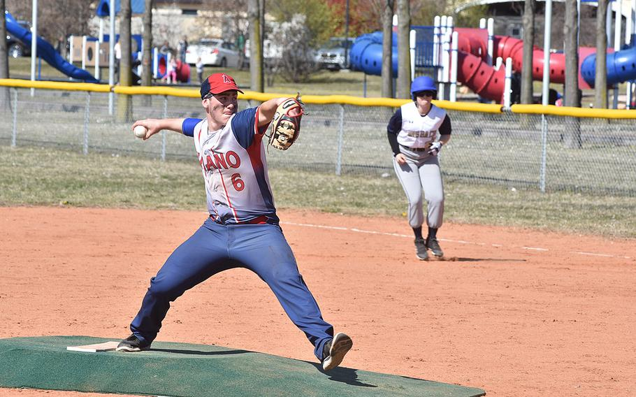 Aviano pitcher Nick Smith readies a pitch while Ansbach's Jacquie Muszczynski leads off first base.