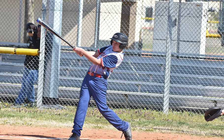 Aviano's Gabe Retamoza drills a triple during the Saints' 16-1 victory over Ansbach on Friday, March 29, 2019.