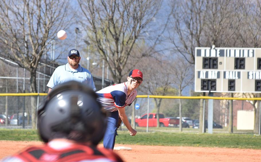 Aviano's Payne Varnum fires a pitch towards catcher Nick Smith in the Saints' 16-1 victory over Ansbach on Friday, March 29, 2019.