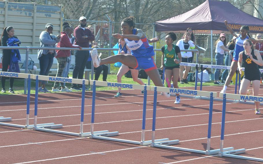 Jaya Worthington, a Ramstein senior, takes a hurdle as she holds onto the lead during the 300-meter race at Wiesbaden High School, Saturday, March 30, 2019.