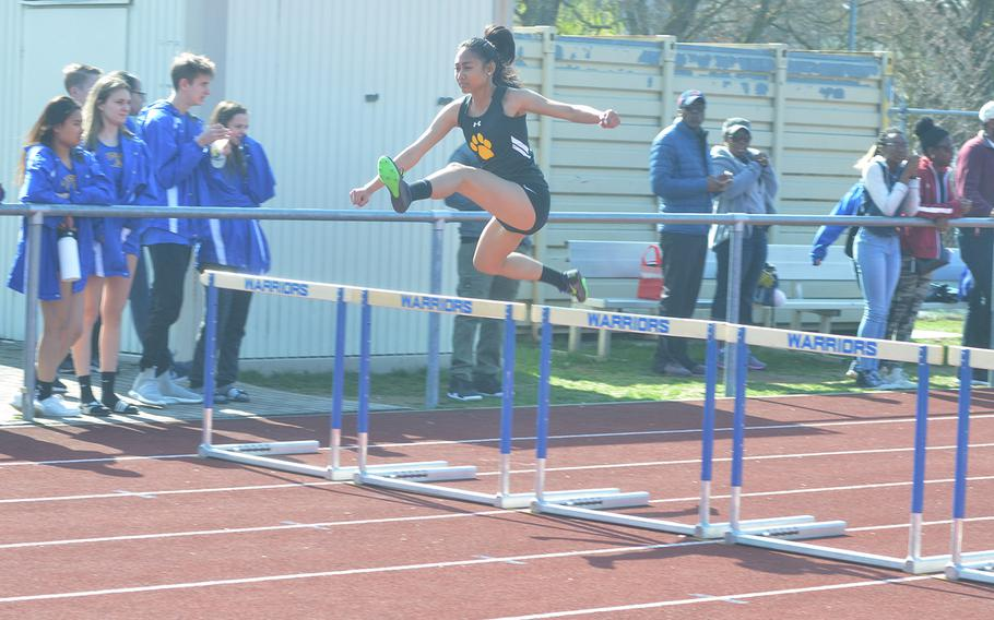 Kaesha Gavina, a student from Stuttgart, jumps over a hurdle during a track meet at Wiesbaden High School, on Saturday, March 30, 2019.