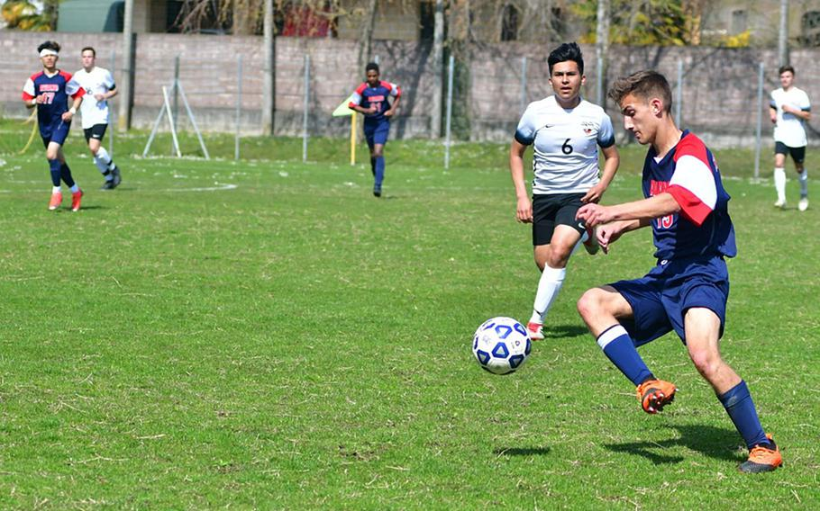 Noah Page of the Aviano Saints tries to break away from Stuttgart defender Will Bermudez during Saturday's game that was played at the Aviano stadium.