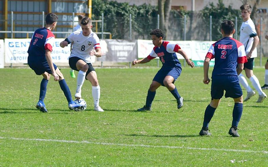 Abe Engelke, a forward with the Stuttgart Panthers, attempts to get by Aviano defenders during Saturday's game that was played at Aviano stadium.