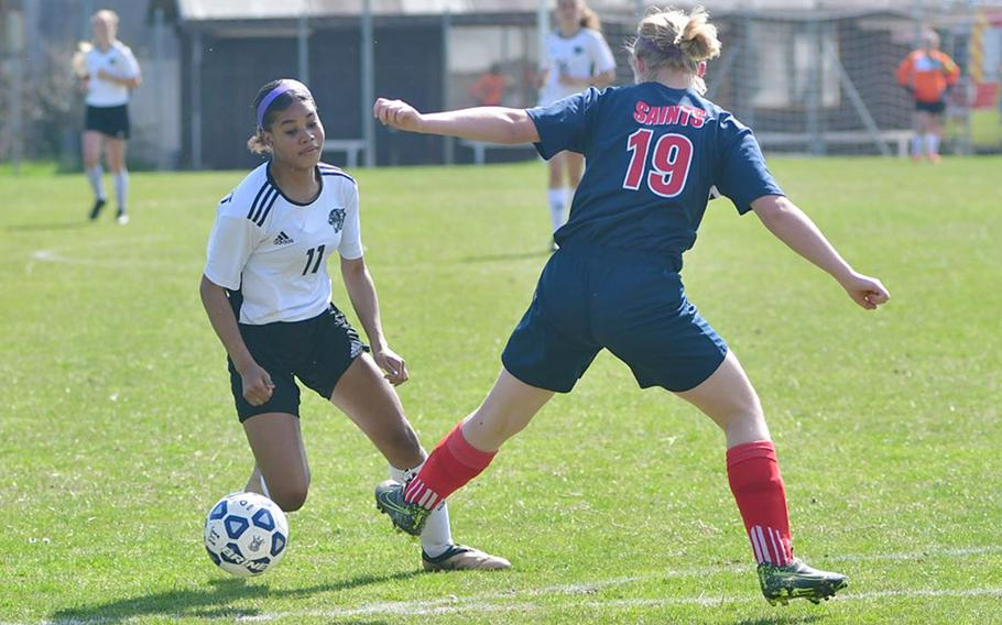 Victoria Antoine, a forward with the Stuttgart Panthers, gets around Aviano's Audrey Belben-Cruz during Saturday's game that was played at the Aviano stadium. Antoine had two assists in the game, which was easily won by the Panthers 7-0.