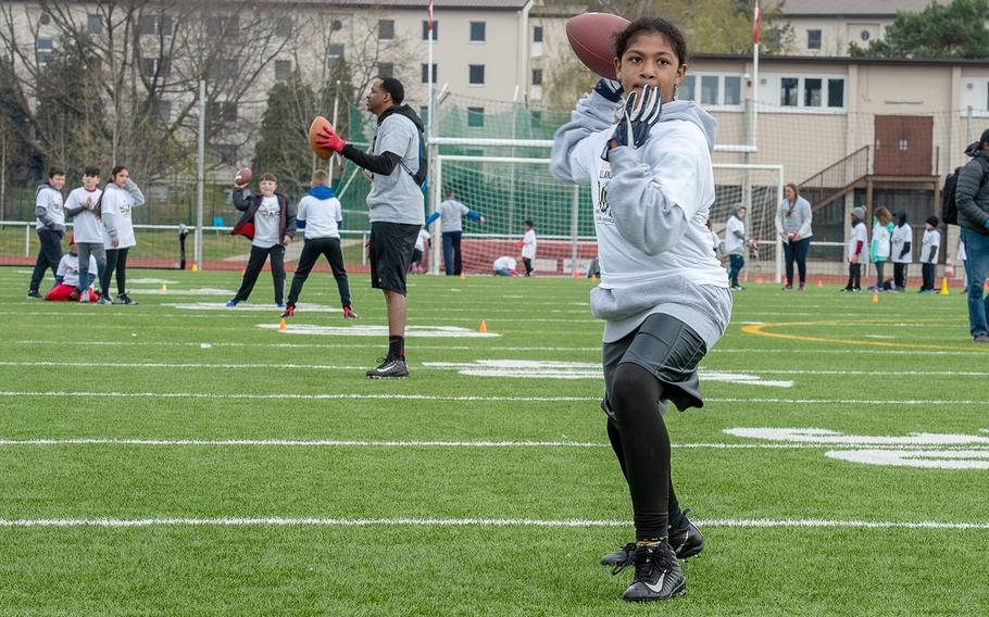 Nathaniel Romero, 14, throws a pass during a quarterback drill at a pro camp at Kaiserslautern High School football field Saturday, April 13, 2019. More than 200 kids from around Germany attended the two-day football camp.