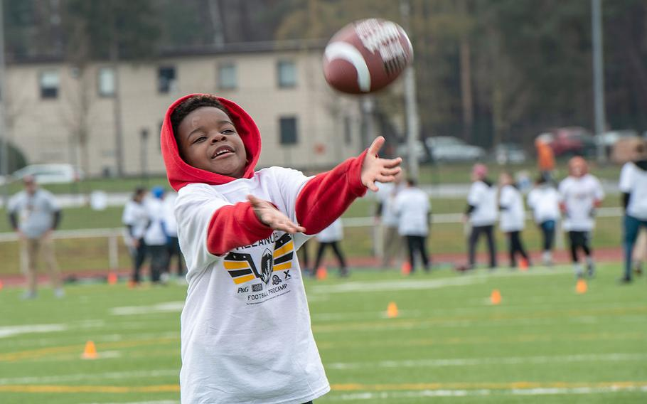 Pro camp participant Xzavier Jennings, 6, tries to catch a pass during a drill at Kaiserslautern High School football field April 13, 2019. More than 200 kids from around Germany attended the two-day football camp.
