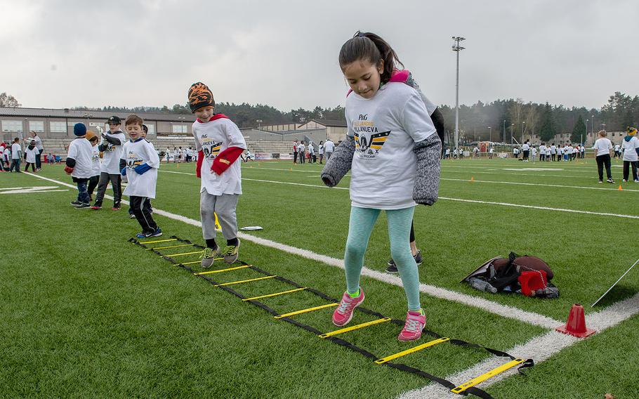 Children practice their footwork during a pro camp at Kaiserslautern High School football field Saturday, April 13, 2019. More than 200 kids from around Germany attended the two-day football camp.