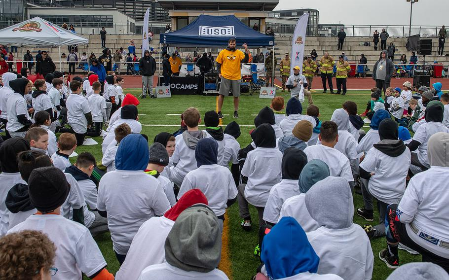 Pittsburg Steelers offensive lineman Alejandro Villanueva talks to kids before a pro camp at Kaiserslautern High School football field Saturday, April 13, 2019. More than 200 kids from around Germany attended the two-day football camp.
