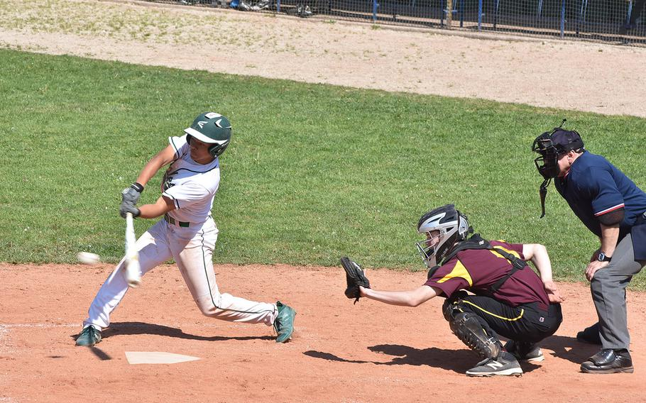 Naples' Keith Rascoe connects on one of his two hits in the Wildcats' 17-6 victory over Vilseck on Friday, April 19, 2019.