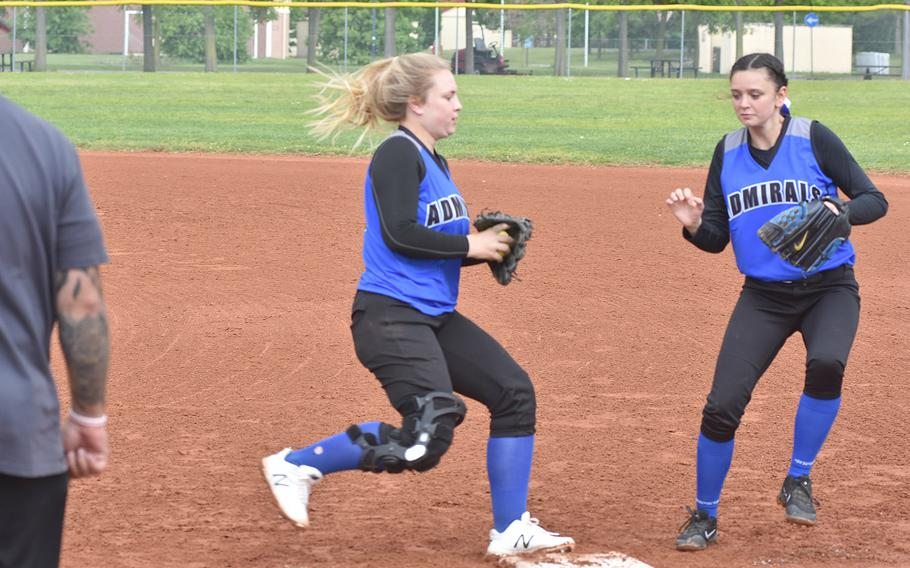 Rota first baseman Emma Bond beats teammate Madeline Sharp to the bag after fielding a grounder Saturday, May 4, 2019, in a game against Aviano at Aviano Air Base, Italy.