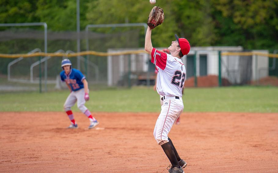 Kaiserslautern's Randy Moon catches a fly ball during a game between Kaiserslautern and Ramstein High Schools, Saturday, May 18, 2019, at Kapaun Air Station, Germany.