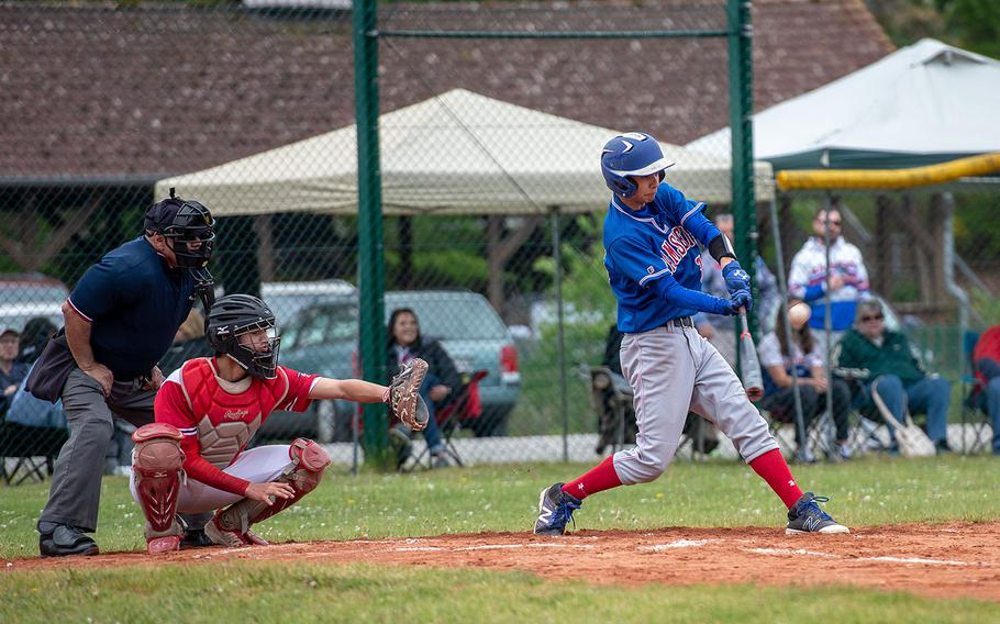 Ramstein's Calvin Delp hits a fly ball during a game between Kaiserslautern and Ramstein High Schools, Saturday, May 18, 2019, at Kapaun Air Station, Germany.
