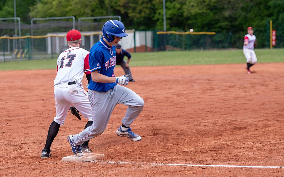 Ramstein's Makani Stenger beats a throw to first base during a game between Kaiserslautern and Ramstein High Schools, Saturday, May 18, 2019, at Kapaun Air Station, Germany.