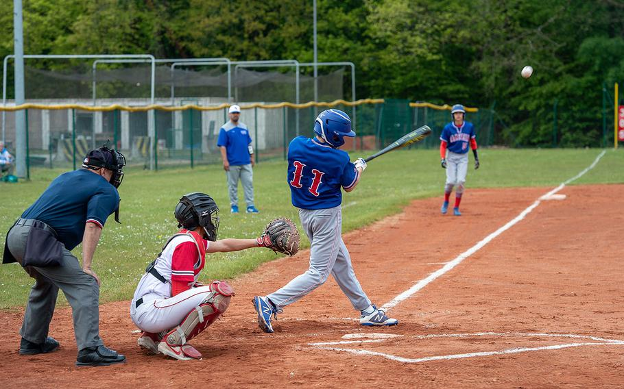 Ramstein's Makani Stenger hits a line drive to left field during a game between Kaiserslautern and Ramstein High Schools, Saturday, May 18, 2019, at Kapaun Air Station, Germany.
