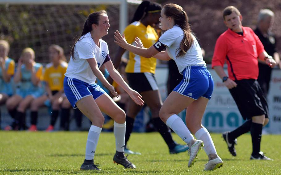 Wiesbaden's Audrey Mehar, right, celebrates with teammate Erin Goodman after scoring the winning 2-1 goal in overtime in a Division I semifinal at Reichenbach, Wednesday, May 22, 2019. Wiesbaden will face Naples in Thursday's final.