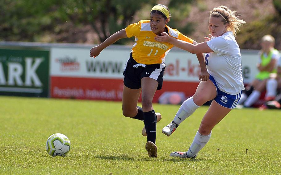 Stuttgart's Victoria Antoine tries to get away from Wiesbaden's Lindsey Barker in a Division I semifinal at Reichenbach, Wednesday, May 22, 2019. Wiesbaden won 2-1 in overtime and will face Naples in Thursday's final.