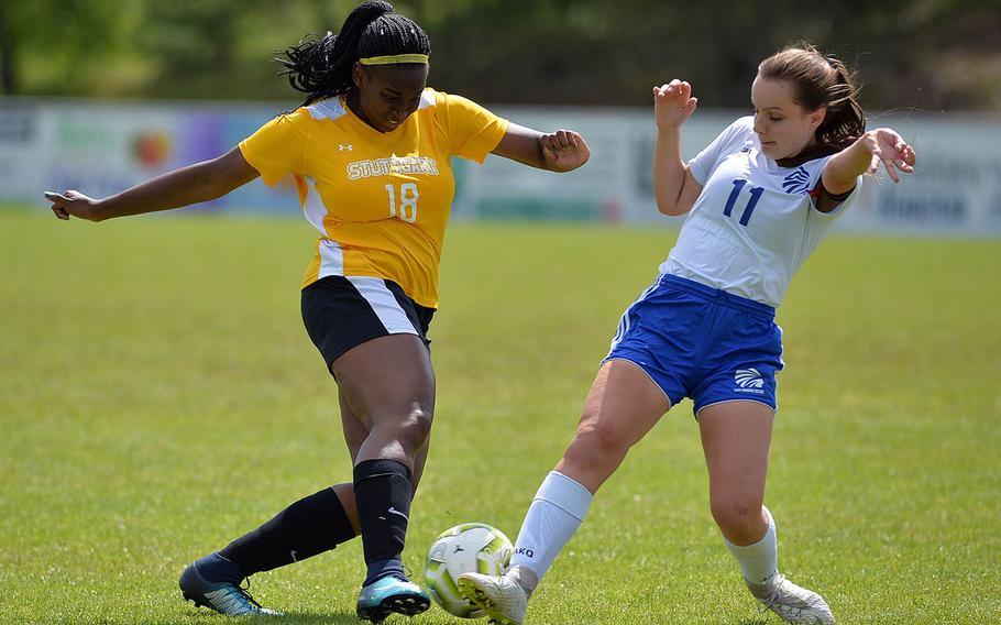 Stuttgart's Skye DaSilva-Mathis and Wiesbaden's Audrey Merhar battle for the ball in a Division I semifinal at Reichenbach, Wednesday, May 22, 2019. Wiesbaden won 2-1 in overtime and will face Naples in Thursday's final.