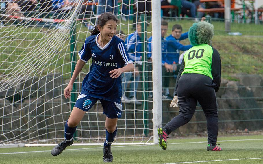 BFA's Yewon Park smiles after scoring a goal against Rota during a Division II semifinal game on the third day of the DODEA-Europe soccer championships, Wednesday, May 22, 2019.