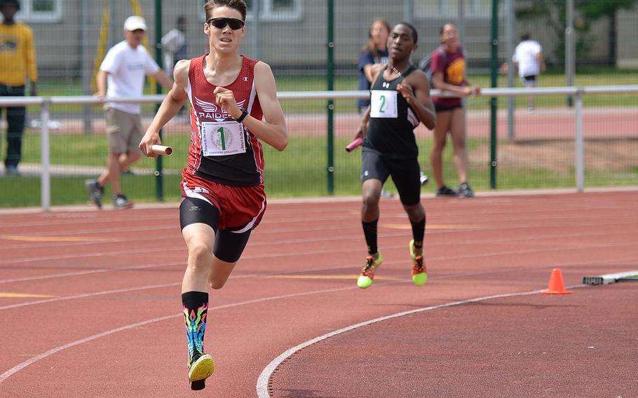 Kaiserslautern's Griffin Parsells speeds around the track as he anchors the Kaiserslautern 4x400-meter relay team at the DODEA-Europe track and field championships. Parsells and teammates Esteban Saldana, Orlando Rojas and Yadiel Rojas won the race in 8 minutes, 18.58 seconds.